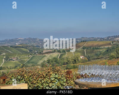 View of a group of wine glasses on the Langhe countryisde. It's a very popular place because of the good wines and food - Stock Photo