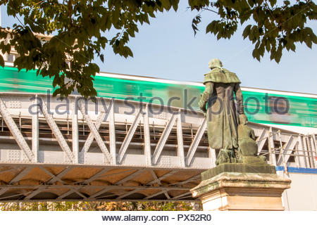 Paris (France), 18 October 2018. Metro line 5 flying over a Parisian square. - Stock Photo