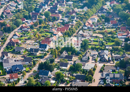 Aerial view of a typical German suburb with detached houses and close neighbourhood, flight with a gyroplane - Stock Photo