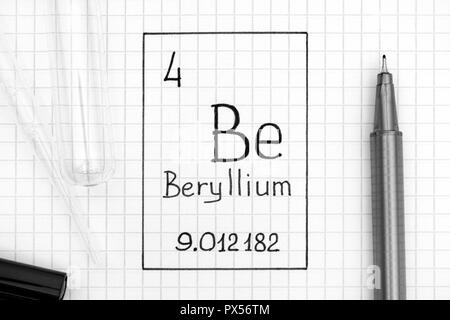 The Periodic table of elements. Handwriting chemical element Beryllium Be with black pen, test tube and pipette. Close-up. - Stock Photo