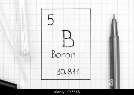 The Periodic table of elements. Handwriting chemical element Boron B with black pen, test tube and pipette. Close-up. - Stock Photo