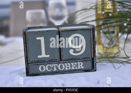 Wood blocks in box with date, day and month 19 October. Wooden blocks calendar - Stock Photo