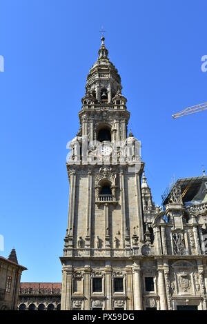 Cathedral: Baroque clock tower close-up with clean stone from Plaza de la Quintana. Santiago de Compostela, Galicia, Spain.