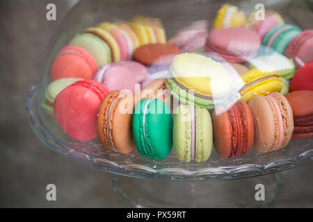Sweet and colorful French macarons in glass bowl. Macarons cakes in glass bowl