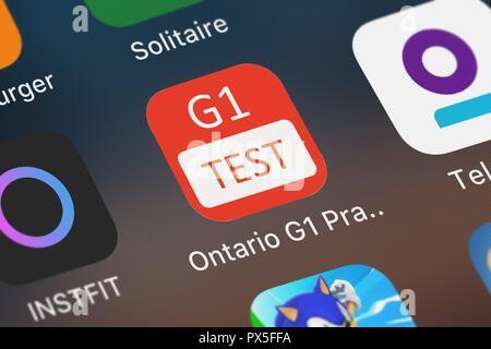 London, United Kingdom - October 19, 2018: Close-up shot of Nhu Quynh Nguyen's popular app Ontario G1 Practice Test. - Stock Photo