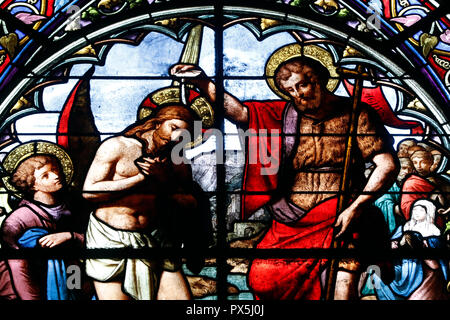 Saint Nizier church.  Stained glass window. The baptism of Jesus by John the Baptist.  Lyon. France. - Stock Photo