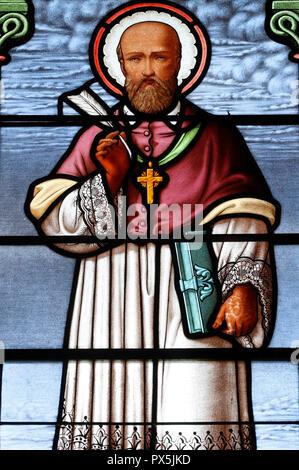 Notre Dame de Bellecombe church.  Stained glass window.  St Francis de Sales.  Notre Dame de Bellecombe. France. - Stock Photo