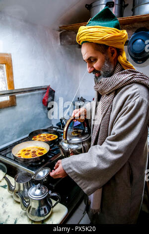 Sufi sheikh preparing a meal in Romilly, France. - Stock Photo