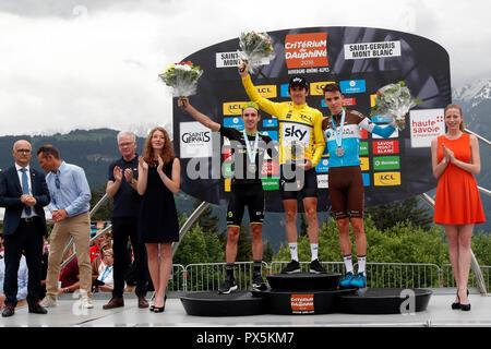 Criterium of Dauphine Libere cycling race 2018.  The official podium.  Adam Yates, Geraint Thomas, Romain Bardet.  Saint Gervais Mont Blanc. France. - Stock Photo