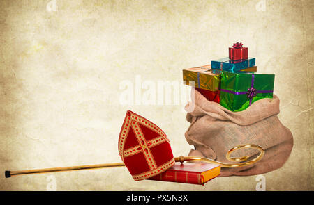 Mitre or miter book, gifts and staff of saint nicholas. Vintage paper background - Stock Photo