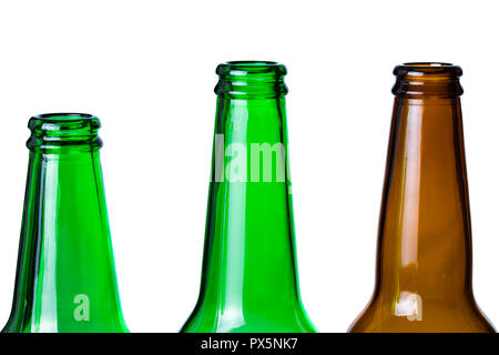 Green and brown glass bottles necks isolated on white background. - Stock Photo