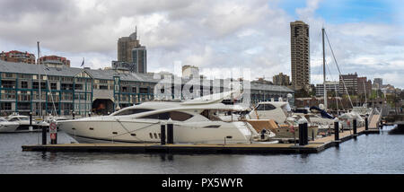 Finger Wharf redevelopment of wooden warehouses now Ovolo Hotel and residential apartments and marina Sydney NSW Australia. - Stock Photo