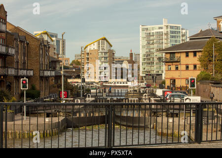 Limehouse Basin and Lock, London,UK, on a Saturday afternoon in October. The lock connects the Basin with the river Thames. Plastic waste is piling up - Stock Photo