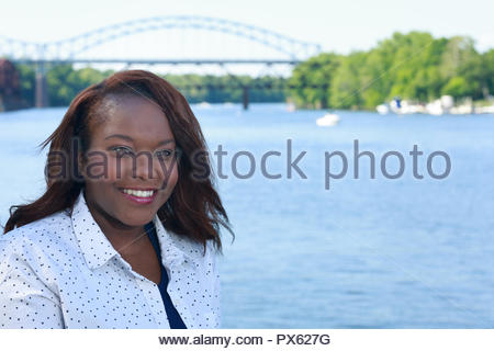 Nice lifestyle shot of a plus size African american woman outside in a casual outfit - Stock Photo
