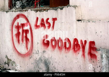 Message on the remaining wall of a demolished house in Shanghai's Puxi district. - Stock Photo