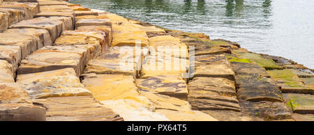Large sandstone blocks laid out to create steps into the Nawi Cove Barangaroo Sydney NSW Australia. - Stock Photo