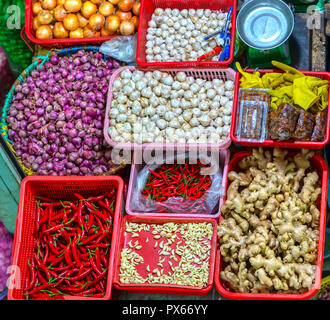 Spices displayed for sale in the market as chilli, ginger, garlic, onion purple. This is an indispensable spice in serving food from animals - Stock Photo