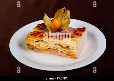 Crust layered cheesecake in the plate - Stock Photo