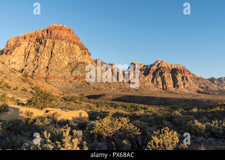 Morning light on Mt Wilson and Rainbow Mountain at Red Rock Canyon National Conservation Area.  A popular natural area 20 miles from Las Vegas, Nevada - Stock Photo