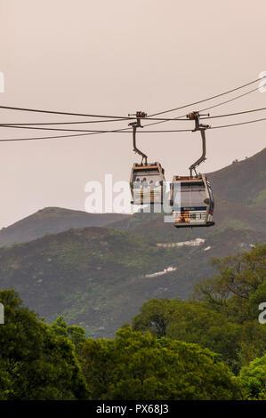 Ngong Ping 360 cable car aerial tram,  The Big Buddha and Po Lin Monastery, Lantau Island, Hong Kong, China. - Stock Photo