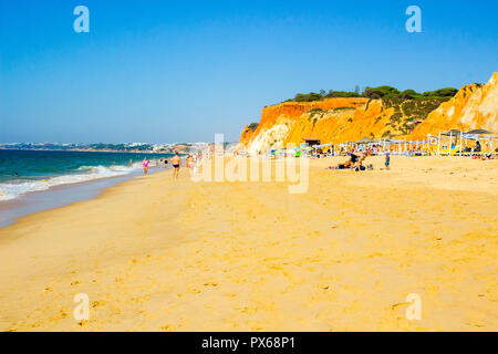 28 September 2018 A view along Falesia Beach ion the Algarve Portugal with its cliffs, sun beds and sand - Stock Photo