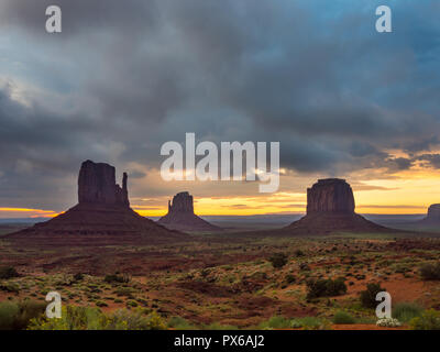 Monument Valley Landscape at Sunrise, Western Mesas, The Mittens - Stock Photo