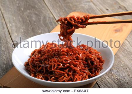 Korean Black Bean Noodle on Wooden Background - Stock Photo