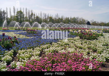 Colorful flowers and fountains in a fantastic park in Dusseldorf - Stock Photo