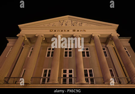 Facade at night of the Danish Bank in Copenhagen with big columns in Ionic order and a decorated pediment, Copenhagen, october 14, 2018 - Stock Photo