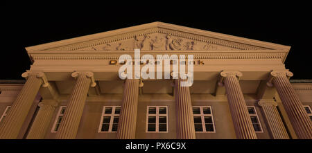 Facade and pediment at night of the Danish Bank in Copenhagen with big columns in Ionic order and a decorated pediment, Copenhagen, october 14, 2018 - Stock Photo