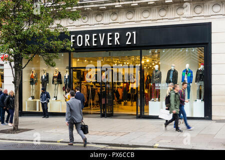 FOREVER 21, is a Californian fast fashion retailer. Shown is shop in Oxford Street, London. - Stock Photo