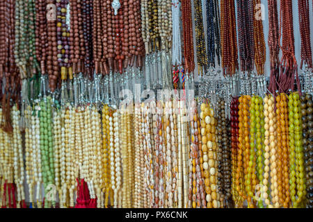 Islamic rosary with different materials, colors and shapes - Stock Photo