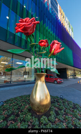 Helsinki New Children's Hospital opened for patients on 17 September 2018. Its colourful facade has sculpture with three red roses in a golden vase. - Stock Photo