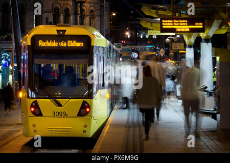 A Metrolink tram bound for Rochdale via Oldham arrives at the Echange Square stop in Manchester City Centre, UK. - Stock Photo