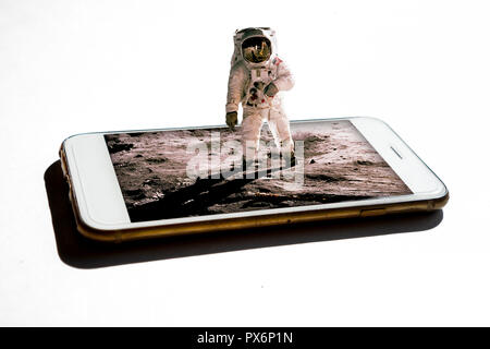 3D astronaut coming out from the smartphone - 3d future technology digital world concept  Elements of this image furnished by NASA - Stock Photo