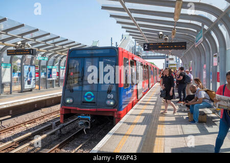Docklands Light Railway (DLR) train in Royal Victoria Station, London, England, UK - Stock Photo