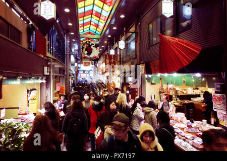 Kyoto Nishiki Market Shopping District, famous historic food market busy with people and many vendor shops in downtown Kyoto, Japan, 2017. - Stock Photo