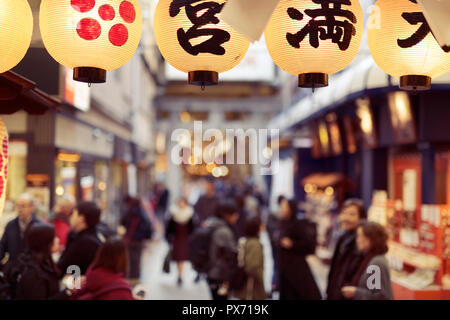 Blurred shoppers in Teramachi shopping arcade, Shinkyogoku popular historical shopping district in Kyoto, Japan 2017 - Stock Photo
