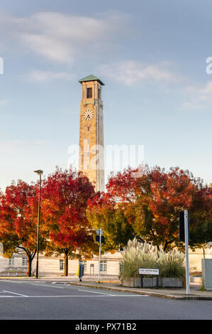 Autumnal street scene with the Civic Centre Clock Tower during autumn 2018 in the city centre of Southampton, Hampshire, England, UK - Stock Photo