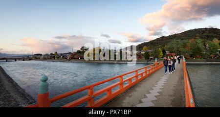 People on the bridge over Uji River in autumn sunset panoramic city scenery. Uji, Kyoto Prefecture, Japan 2017 - Stock Photo