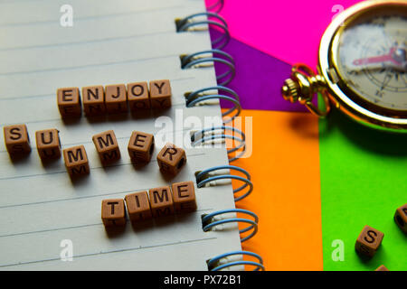 Enjoy summer time message written on wooden blocks. Vacation and travel concepts. Cross processed image - Stock Photo