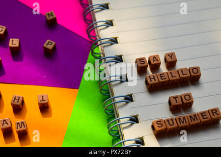 Say hello to summer message written on wooden blocks. Vacation and travel concepts. Cross processed image - Stock Photo