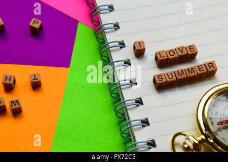 I love summer message written on wooden blocks. Vacation and travel concepts. Cross processed image - Stock Photo