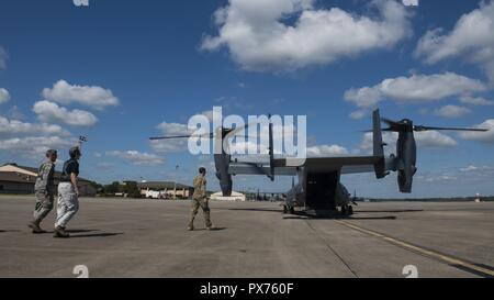 Secretary of the Air Force Heather Wilson steps to a CV-22 Osprey tiltrotor aircraft assigned to the 8th Special Operations Squadron at Hurlburt Field, Florida, Oct. 14, 2018, October 14, 2018. Aircrew members with the 8th SOS transported Air Force senior leaders from Hurlburt Field to Tyndall Air Force Base to assess the damage from Hurricane Michael, one of the most intense tropical cyclones to ever hit the U.S. (U.S. Air Force photo by Senior Airman Joseph Pick). () - Stock Photo