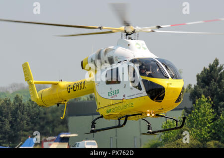 Essex and Herts Air Ambulance landing at Earls Colne. G-EHAA. MD900 Explorer helicopter, medical emergency response. Specialist Aviation Services - Stock Photo