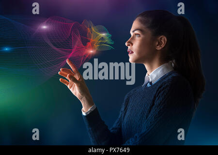 concept of a young woman selecting colors on projected rainbow color spectrum vector lines of cloud shape - Stock Photo