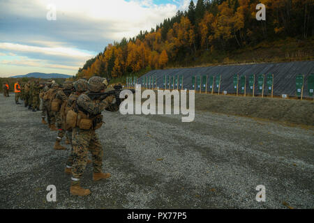 The Norwegian Home Guard trains U.S. Marines with 2nd Marine Logistics Group-Forward on different rifles used by the Norwegians during Exercise Trident Juncture 18 in Hell, Norway, Oct. 12, 2018. The Norwegians trained U.S. Marines on the familiarization of different rifles used by the Norwegians to enhance the U.S. and NATO Allies' and partners' ability to work together collectively to conduct military operations under challenging conditions. (U.S. Marine Corps photo by Gunnery Sgt. Jason W. Fudge) - Stock Photo