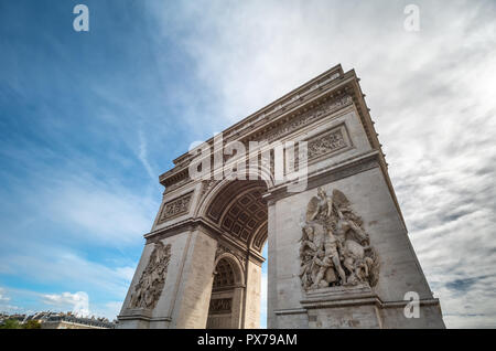 Looking up to the Arc de Triumph in a Bright Sunny Day in Paris - Stock Photo
