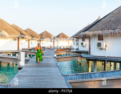 Water villas in a row by the seashore, Maldives. Copy space for text - Stock Photo