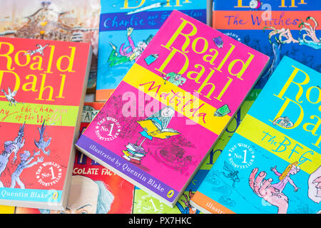stack pile of childrens books, kids books, children favourites, roald dahl book, matilda bfg chocolate factory witches, kids favourite author classics - Stock Photo